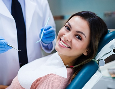 Woman smiling at dental office