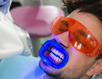 Man receiving teeth whitening