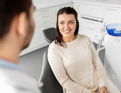 Patient smiling while talking to a cosmetic dentist