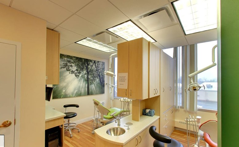 Looking into dental treatment room from hallway